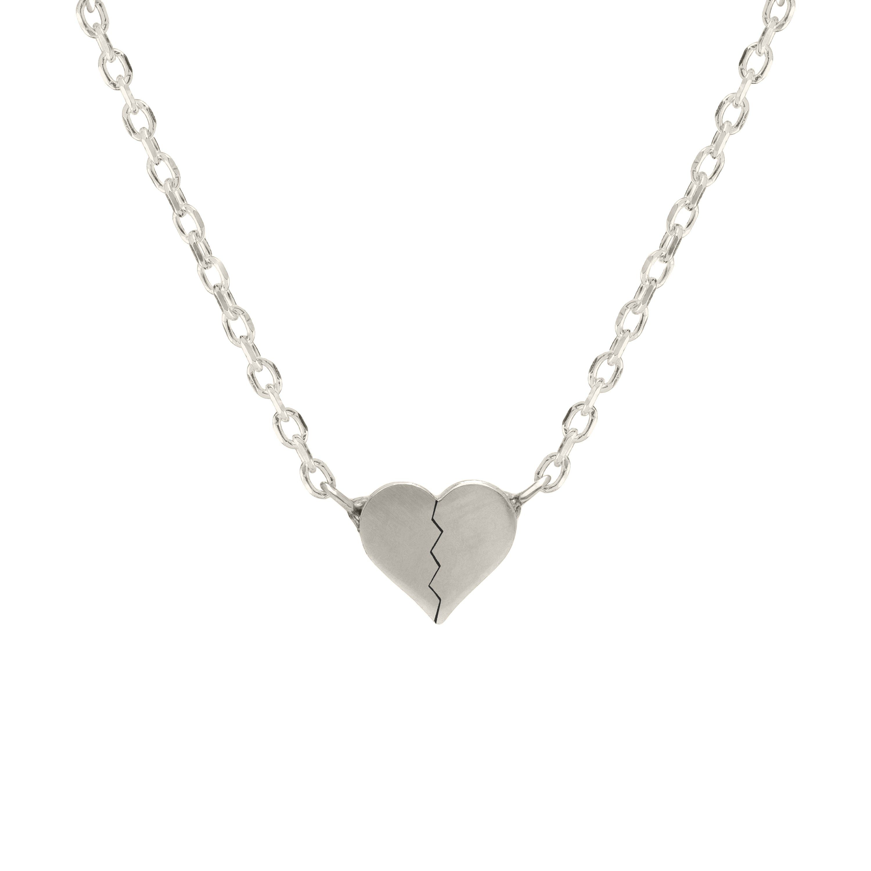 Tiny Hearts Forever Pendant Description: The Tiny Hearts Forever Pendant necklace may be small. But, it is meant to be a powerful everyday reminder to be confident and proud of the person you are today while wearing it; no matter whether your heart feels broken or whole. Our HOMS Tiny Hearts Forever Pendant is part of the Hearts Forever Collections by Allison Claire. Silver or Solid 14K Yellow Gold Reversible. One side is a whole heart and the other is a broken heart. each heart is 4mm tall Adju