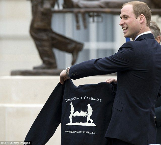 Prince William was presented with a sweat shirt for his wife Catherine, Duchess of Cambridge, during the visit