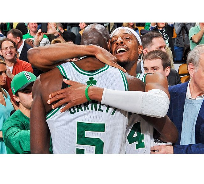 Paul Pierce (54 minutes) hugs Kevin Garnett (47) after the two made big plays in overtime to defeat the Nuggets.