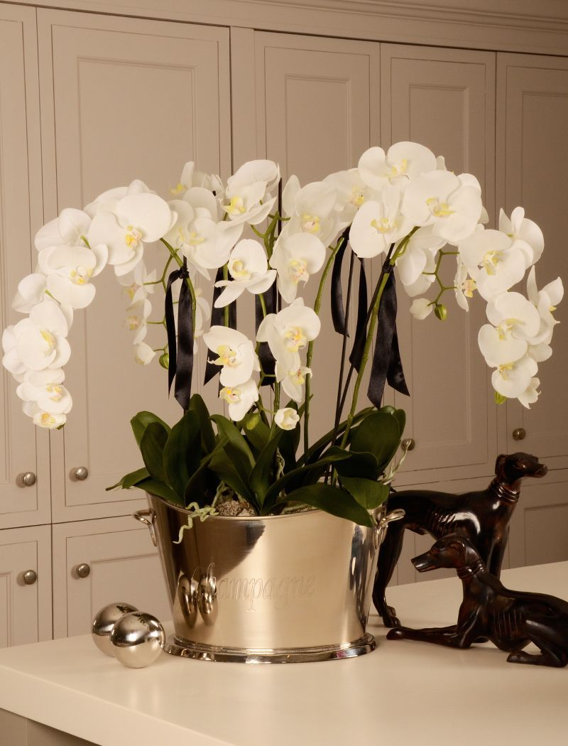 Orchid In A Large Champagne Cooler Rtfact Artificial Silk Flowers Artificial Flower Arrangements Orchid Flower Arrangements Artificial Floral Arrangements