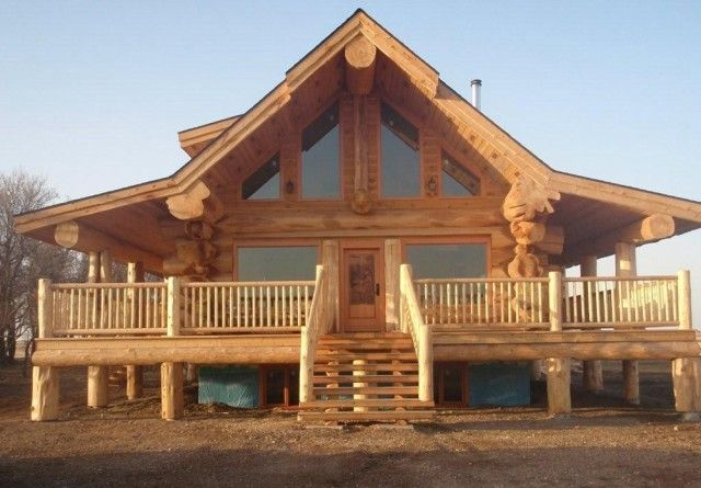 Stunning log homes designed by pioneer log homes of for Log cabin furniture canada
