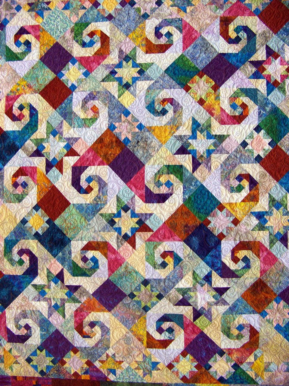 Rising Star And Snail S Trail Combined On A Brightly Colored Quilt Quilts Quilt Patterns Traditional Quilts