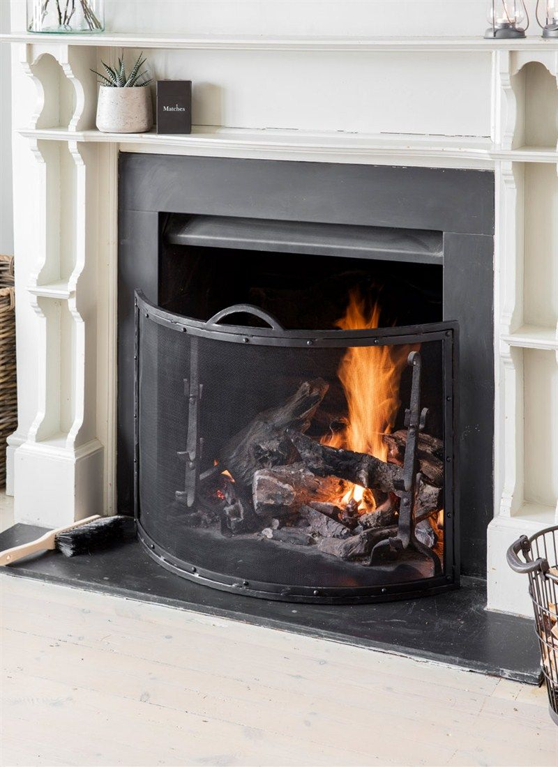 The curved firescreen has a streamlined design and crafted in
