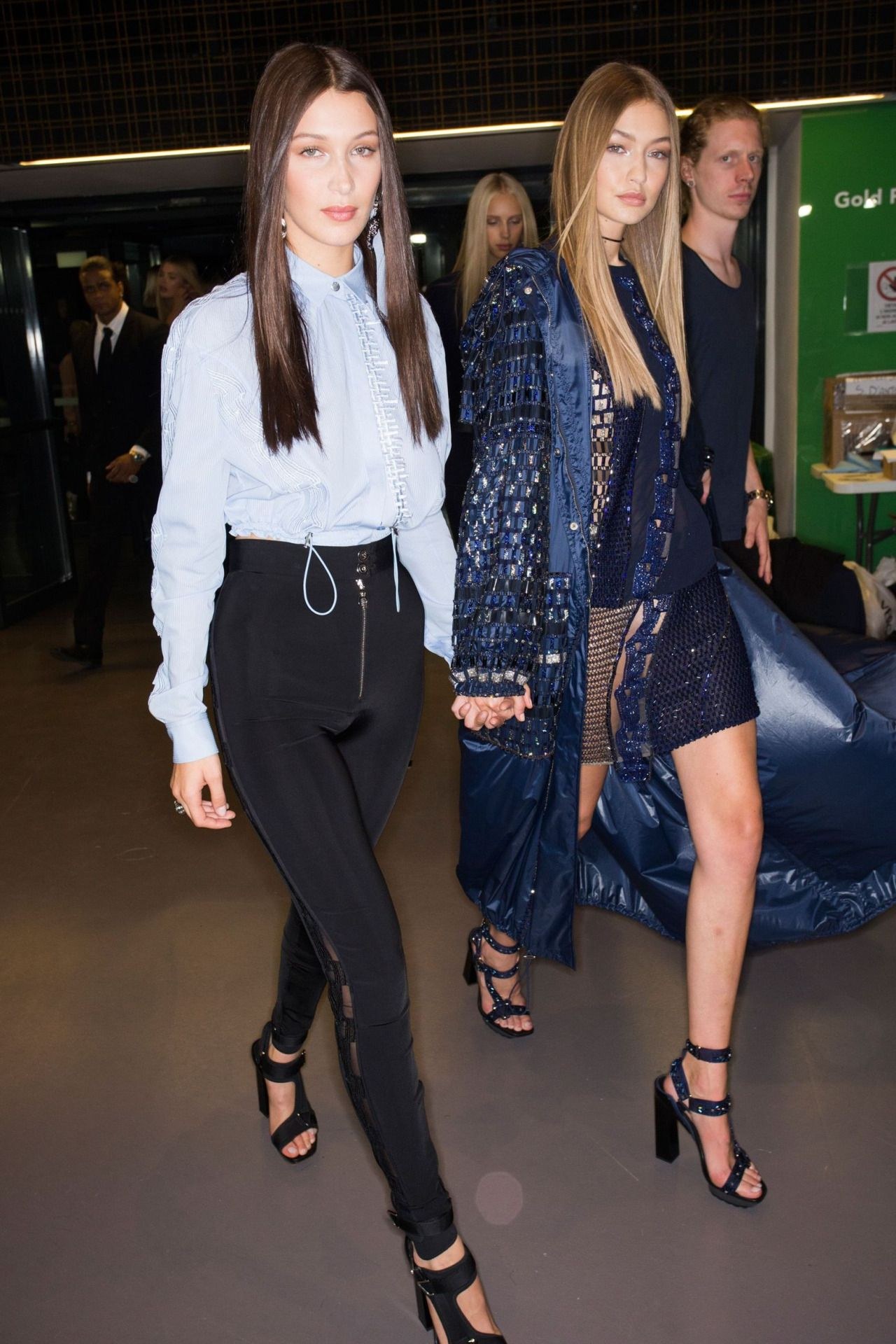 Gigi and Bella Hadid backstage at the Versace show during ...