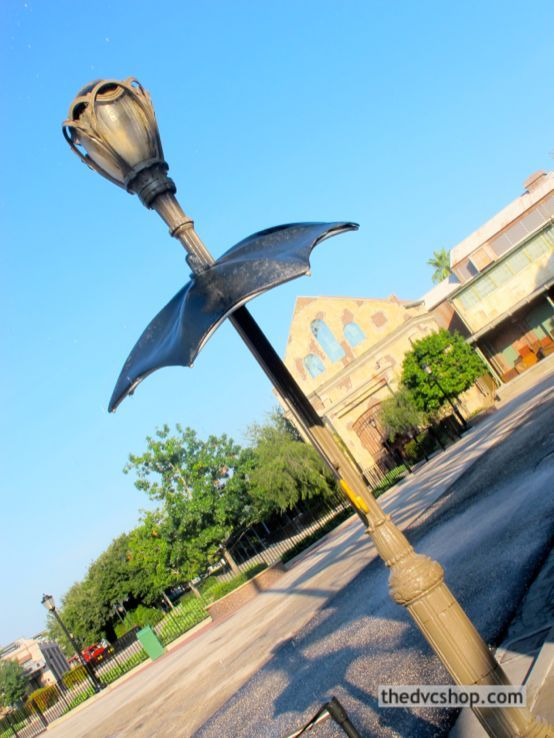 """A fun find in Disney's Hollywood Studios is the """"Singin' in the Rain"""" umbrella positioned under a street lamp in the Streets of America. Grab the handle and step back onto a pressure plate to make it rain onto the umbrella and do your best Gene Kelly impersonation. Tip: it might seem like a great photo-op, but unless you've got a very good camera, you probably won't capture the """"rain"""" very well (that's why the original movie is said to have used watered-down milk for the """"rain"""")."""
