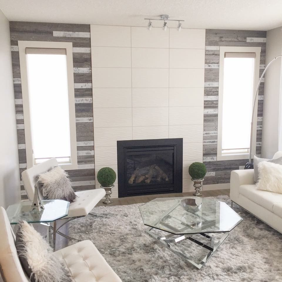 modern tiles around fireplace and barnboard accents basement