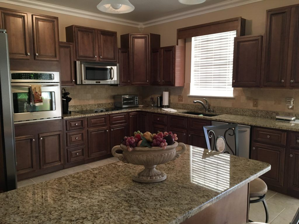 Espresso Stained Kitchen Cabinets Granite Counter Tops In Updated Kitchen With Tumbled Tra Stained Kitchen Cabinets Espresso Kitchen Cabinets Kitchen Cabinets
