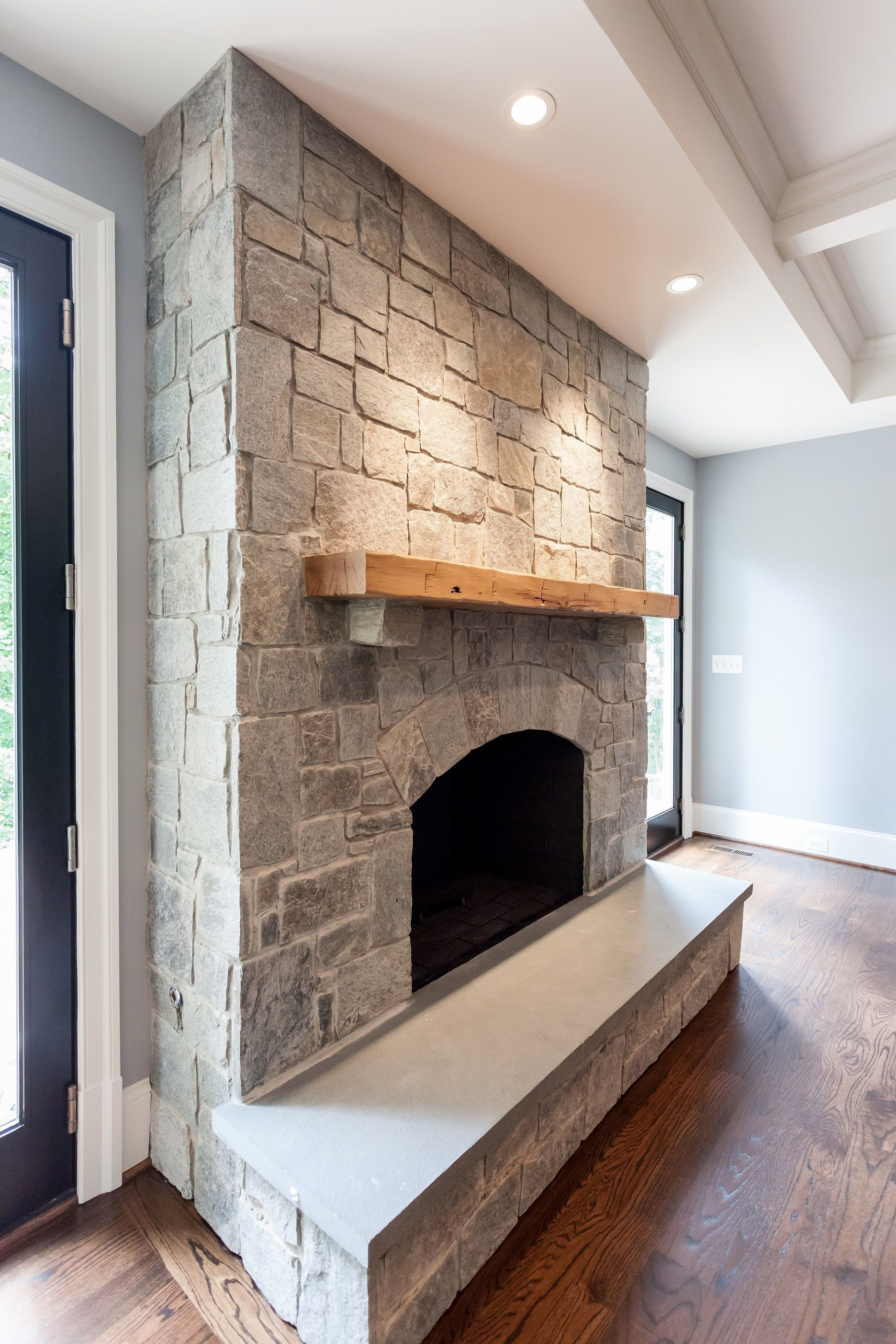 Natural Gray Stone Fireplace With Reclaimed Natural Wood Mantel And Arched Firebox Openin Grey Stone Fireplace Natural Stone Fireplaces Stone Fireplace Remodel