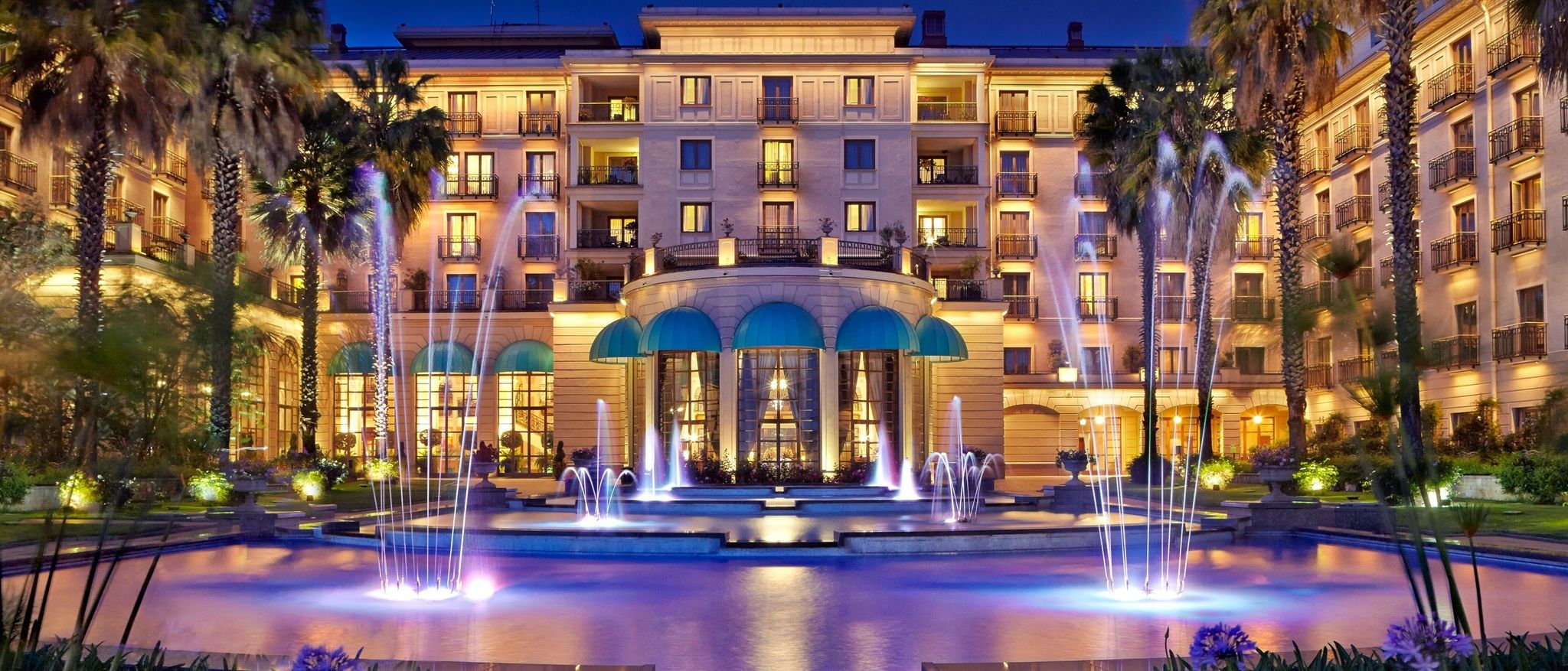Sheraton Addis Main Entrance Lit Up At Night With Fountain In Foreground Luxury Collection Hotels Entrance Lighting Main Entrance
