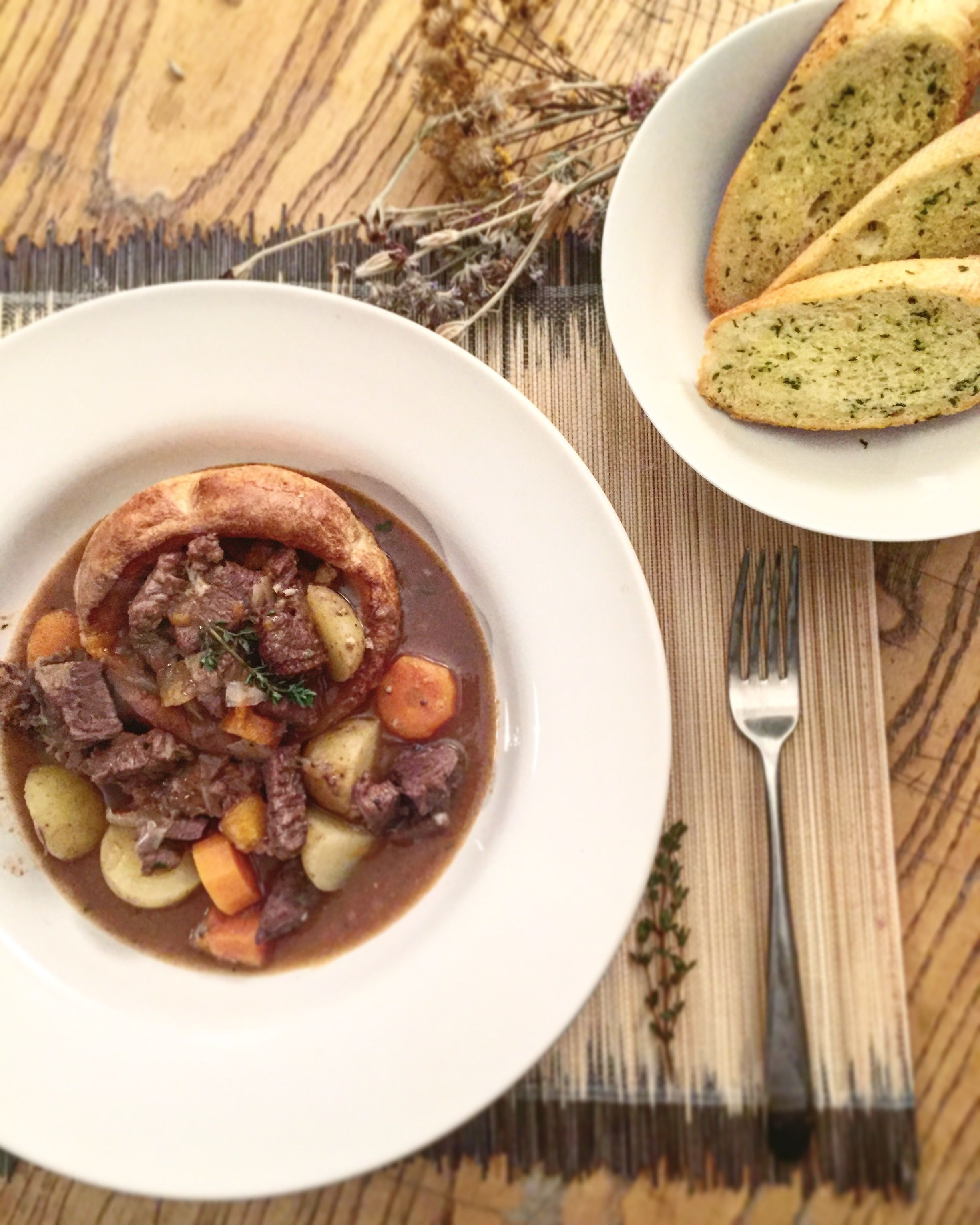 Home made winter beef and red wine stew with garlic bread