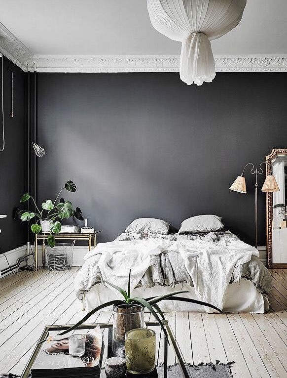 Love the dark grey wall in this bedroom!