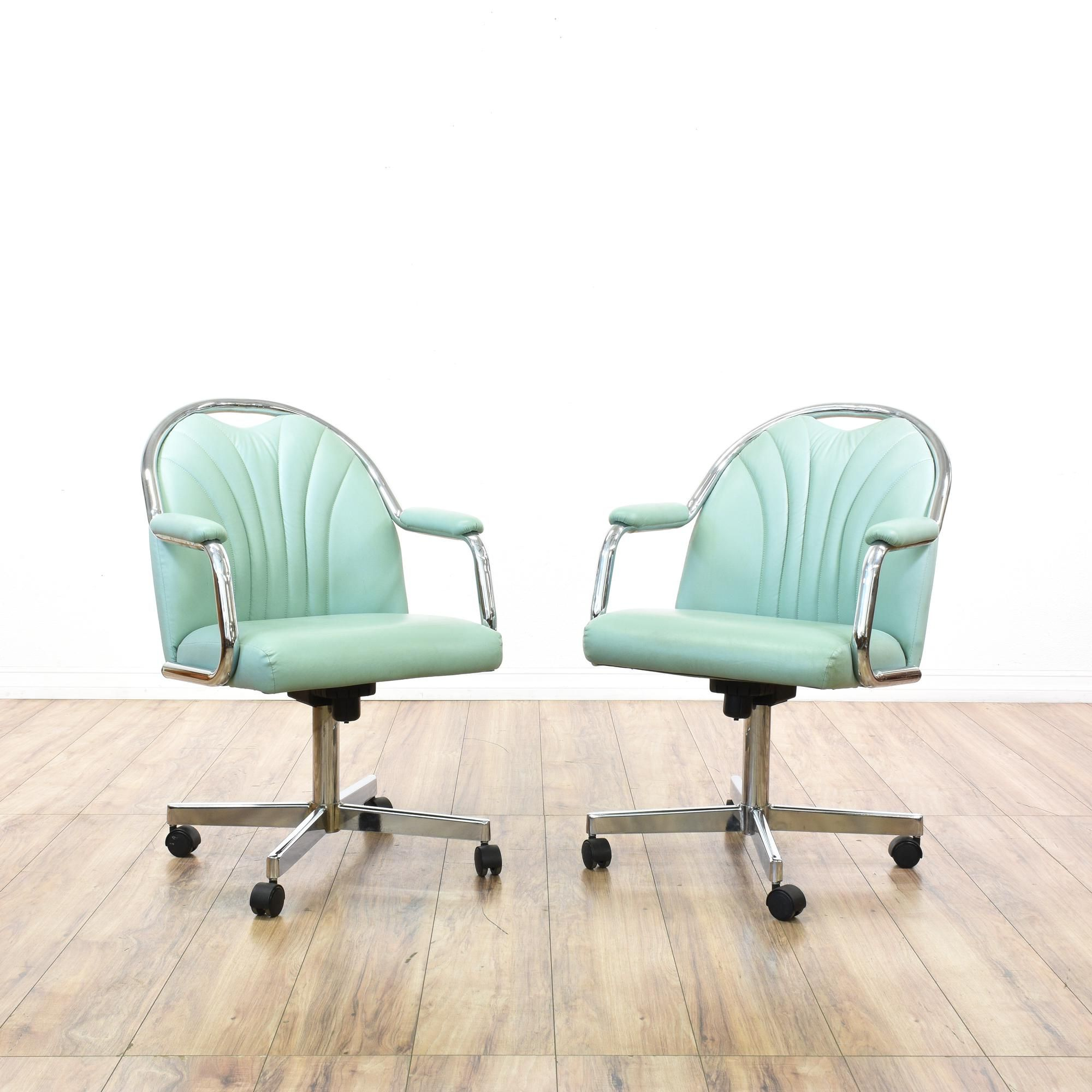This pair of swivel chairs is featured in a shiny polished chrome