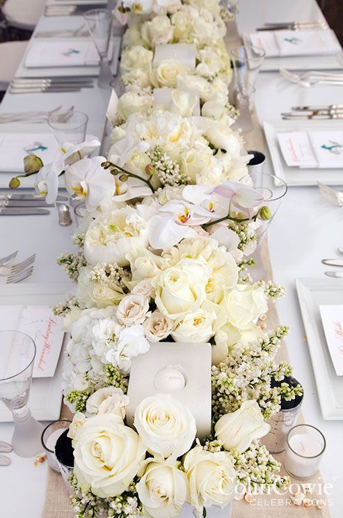 Full table white flower wedding reception centerpiece wedding photographer colin miller via colin cowie weddings elegant white flower wedding reception centerpiece mightylinksfo