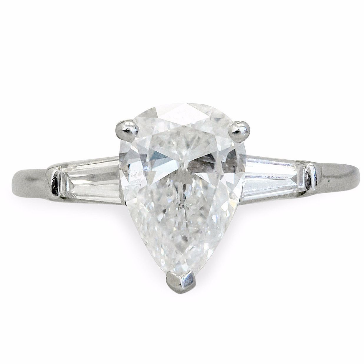 Pearshape engagement ring with baguette sides pear engagement