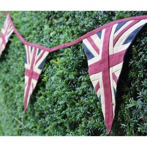 """BEST OF BRITISH BUNTING Beautifully crafted, out vintage Union Jack bunting is superbly constructed from woven 100% pure cotton, backed in navy and set on a cotton """"string"""". Perfect for all manner of indoor or outdoor family and community celebrations, it measures a generous 3.9m long with tie ends to hang from trees, hooks or along a staircase. Machine washable."""