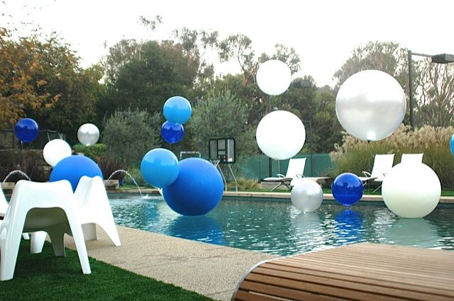 Big balloons in pool weighted tied with fishing line so for Pool decorations