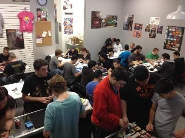 It's Friday night and River City Comics + Games is bustling. The proprietor, Joe Scheib, oversees the crowd. It is, literally and figuratively, a gathering, as in Magic: The Gathering, the trading card game that has players assuming the roles of battling wizards. Every week is Friday Night Magic. Read more at http://natomasbuzz.com