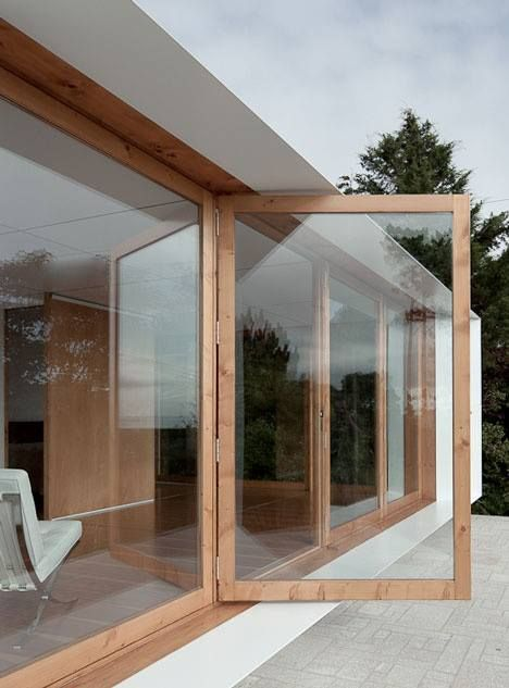 Photo of glass door; so do we want wooden framing or black? modern but warm