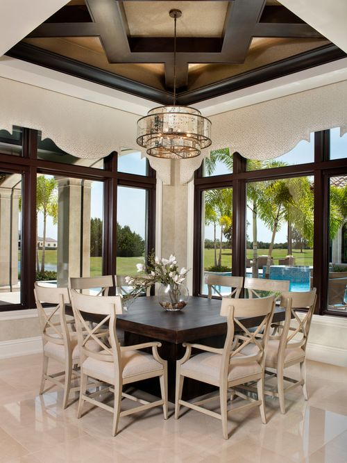 Magnificent dining room with high ceilings and a beige ...