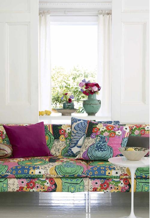 Colourful printed sofa in a cool white interior
