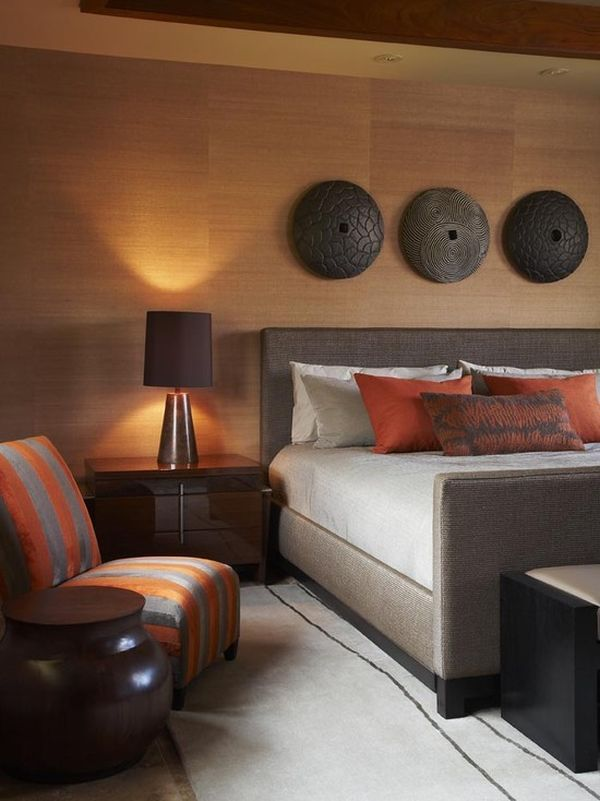 The warmth of the wood (or wood effect) wall and use of rusts and browns combined with ivory make for a warmth and comfort that is very seductive . . .