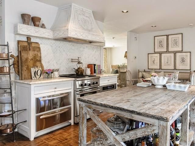 french country kitchen with white cabinets highlighting a distressed