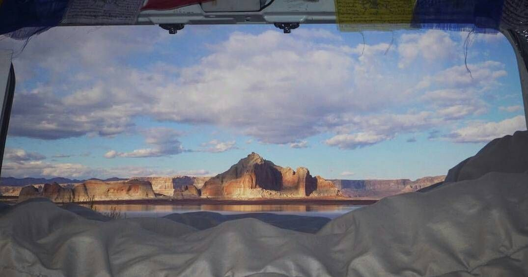 Now that's what a room with a view looks like!   Loving this shot @emileonwheels took of Lake Powell. That is one awesome view from the backdoor of the ol white van. Awesome   #vandwellinglife is your hashtag to use when sharing your pics...we can't wait to share! by vandwelling_life