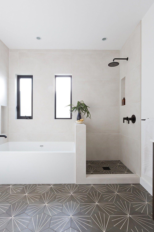 Black fixtures in the bathroom + patterned floor tile in ...