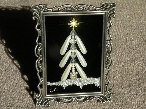 Christmas tree made from a vintage costume jewelry in vintage