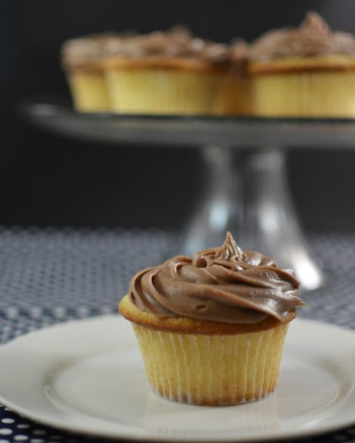 These homemade yellow cupcakes are as easy to make and taste even better than a box mix. Topped with delicious homemade chocolate frosting