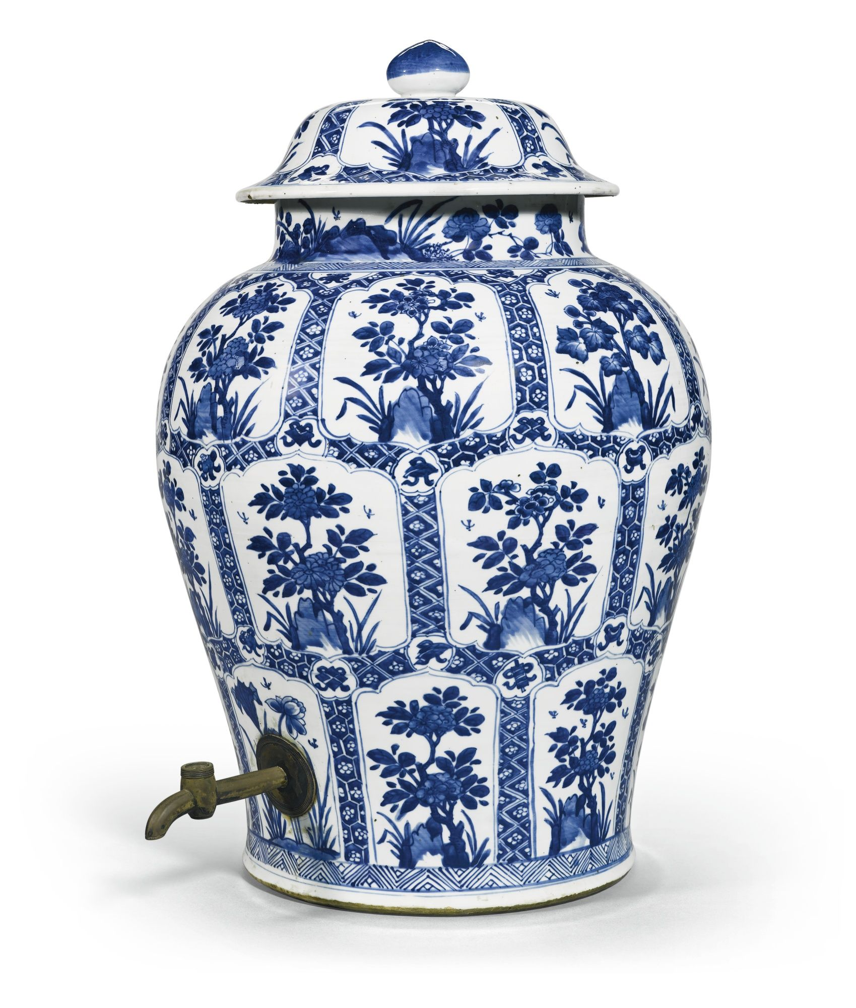 BLUE AND WHITE 'FLORAL' JAR AND COVER QING DYNASTY, KANGXI PERIOD the baluster body painted with three rows of petal-shaped floral panels, all reserved on diaper grounds interspersed with small cartouches enclosing the babao (Eight Treasures), the foot and the shoulder encircled with chevron bands, the neck with flowers issuing from rocks, mounted with a metal tap, the domed cover similarly decorated Quantity: 2 56.5cm., 22 1/4 in.