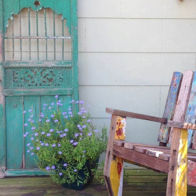 Beautiful Balinese gate and recycled boat chair.