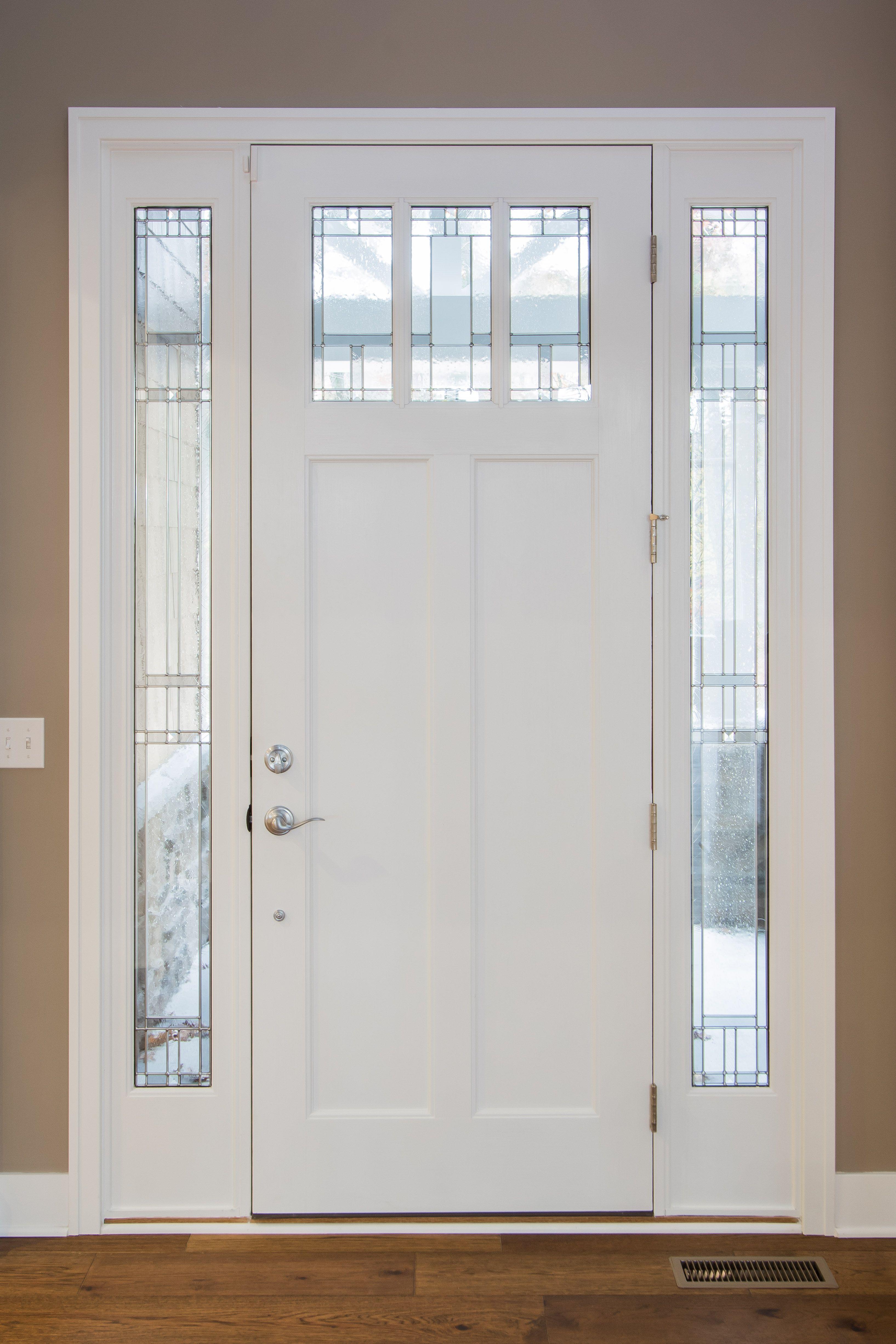 Entry Door Painted Trim, Decorative Glass Panels, Hardwood Floors