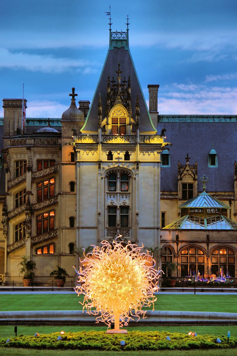 Biltmore House With Chihuly Glass Sculpture At Sunset In Asheville
