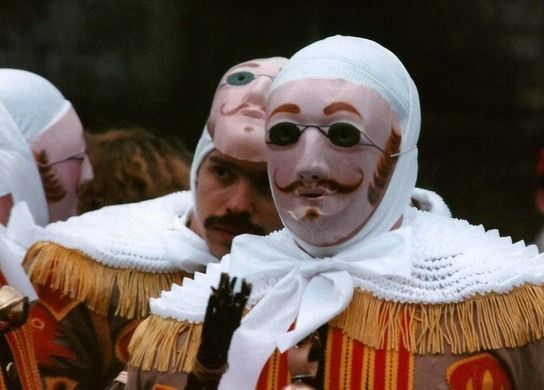 This tiny Belgian town's ancient version of Mardi Gras involves eerie wax masks, sticks for warding off evil, ostrich plume hats, and oranges