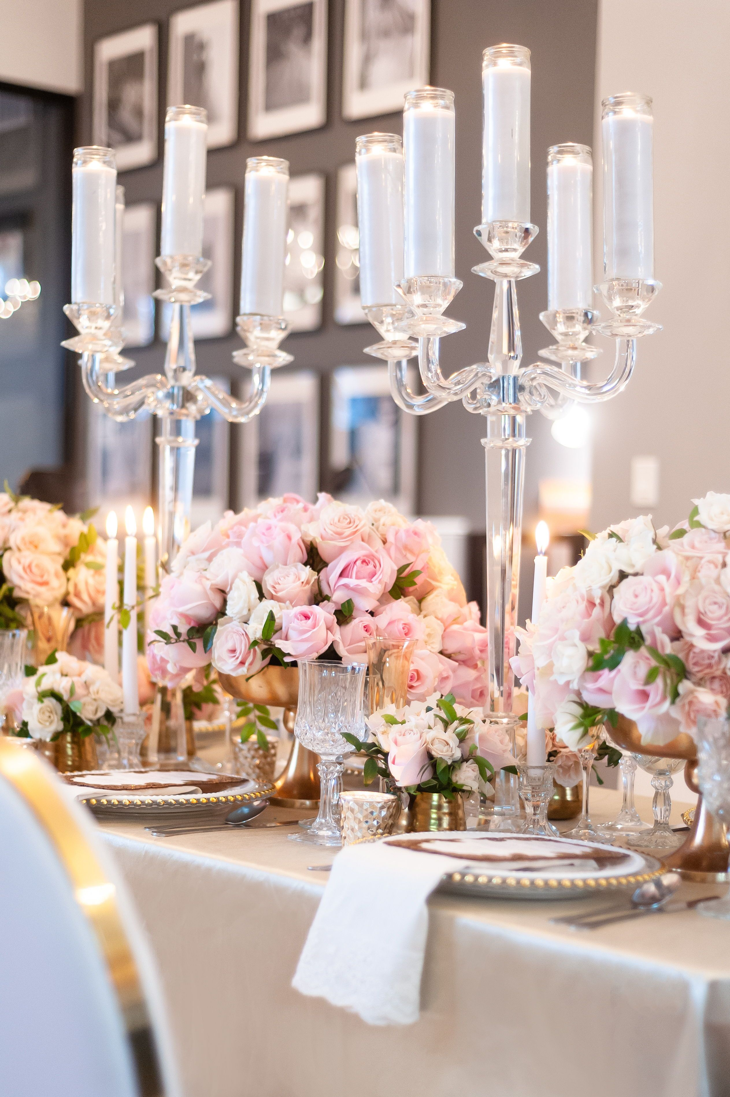Long wedding table decor with low centerpieces, pink flowers and roses, and crystal candelabras | New Jersey Top Wedding Planner | Party Planner | Floral Design | JP Events And Design#table #tablesetting #tablescape #tabledecor #centerpieceideas #weddingdecor #weddingdecorations