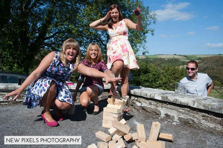 New Pixels Wedding Photographer captures the giant jenga falling at this wonderful bride and grooms wedding. Wedding entertainment and games.