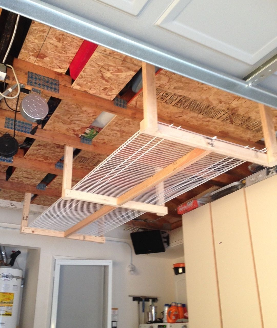 DIY overhead garage storage rack...four 2x3's, and two 8'x16\