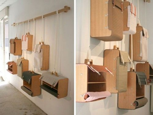 Wooden shelves made to look like old suitcases by Lotty Lindeman