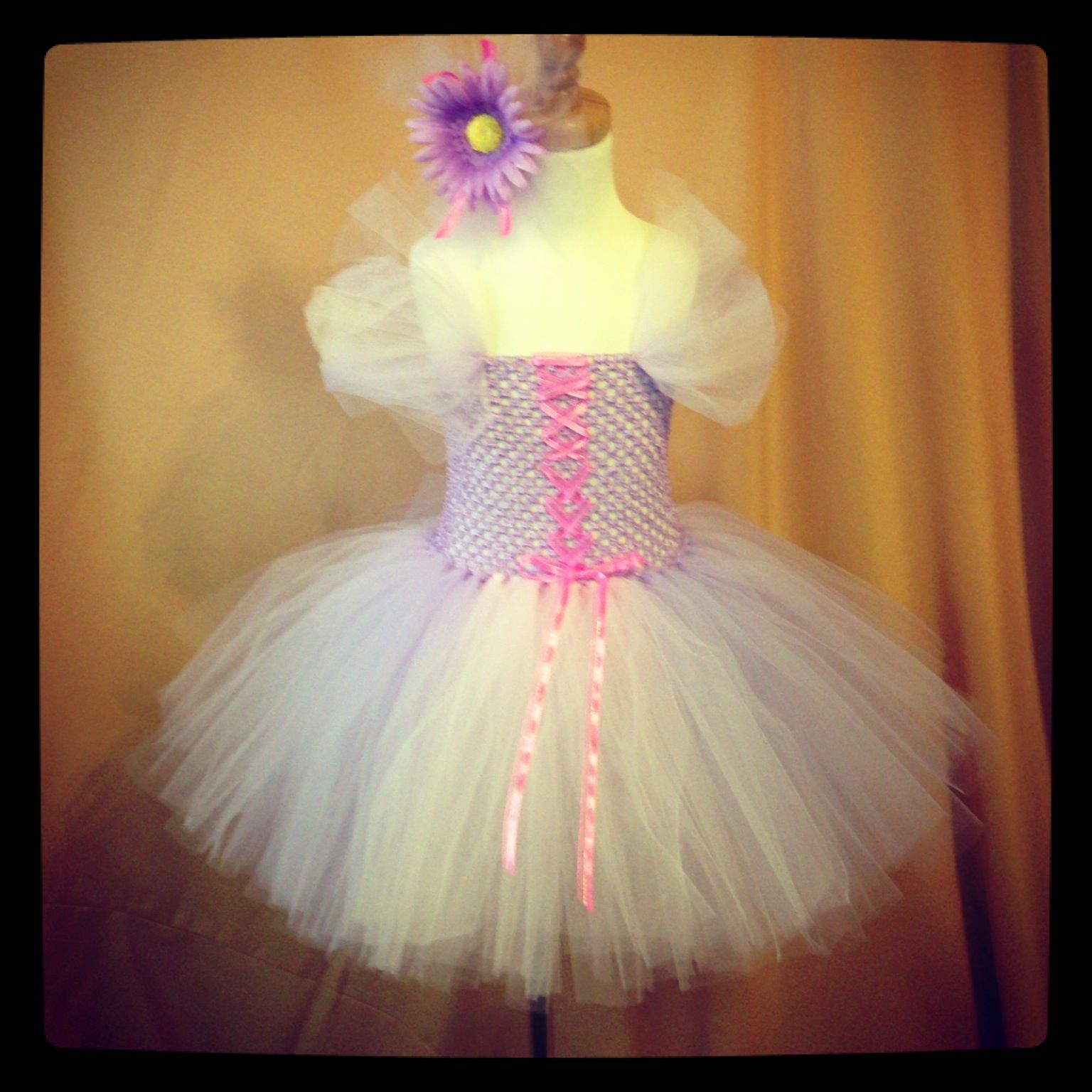 Rapunzel. Two Girls Tutus and Scarves. Find us on Facebook. Will be opening an etsy store soon.