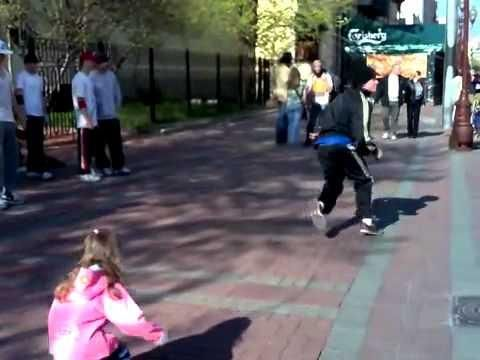 Little Girl Tries To Imitate Street Performer