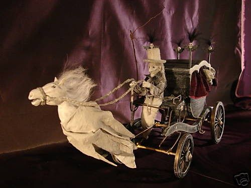 The Haunted Carriage was designed by artist Pat Benedict, or Woopitydooart. For Pat, Halloween comes all year round. If your dollhouse is ha...