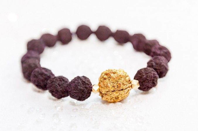 A bracelet at Jai Mala Rose featuring a 14k goldpainted Rudraksha