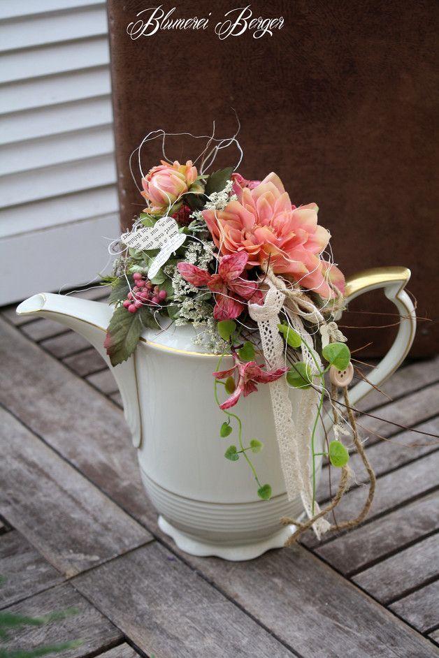 Photo of Vintage coffee pot with floral arrangement, romantic wedding decoration / for a r …