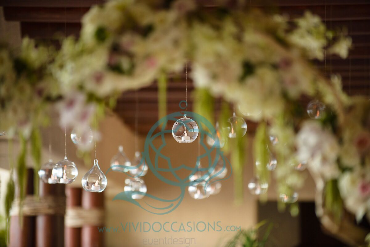 Hanging #lights and a #flower #arch framing the entrance to the #wedding #reception. Www.vividoccasions.com and Www.cabofloralstudio #cabowedding #destinationweddingplanner #destinationwedding #weddingplanner #weddingideas #weddingflowers