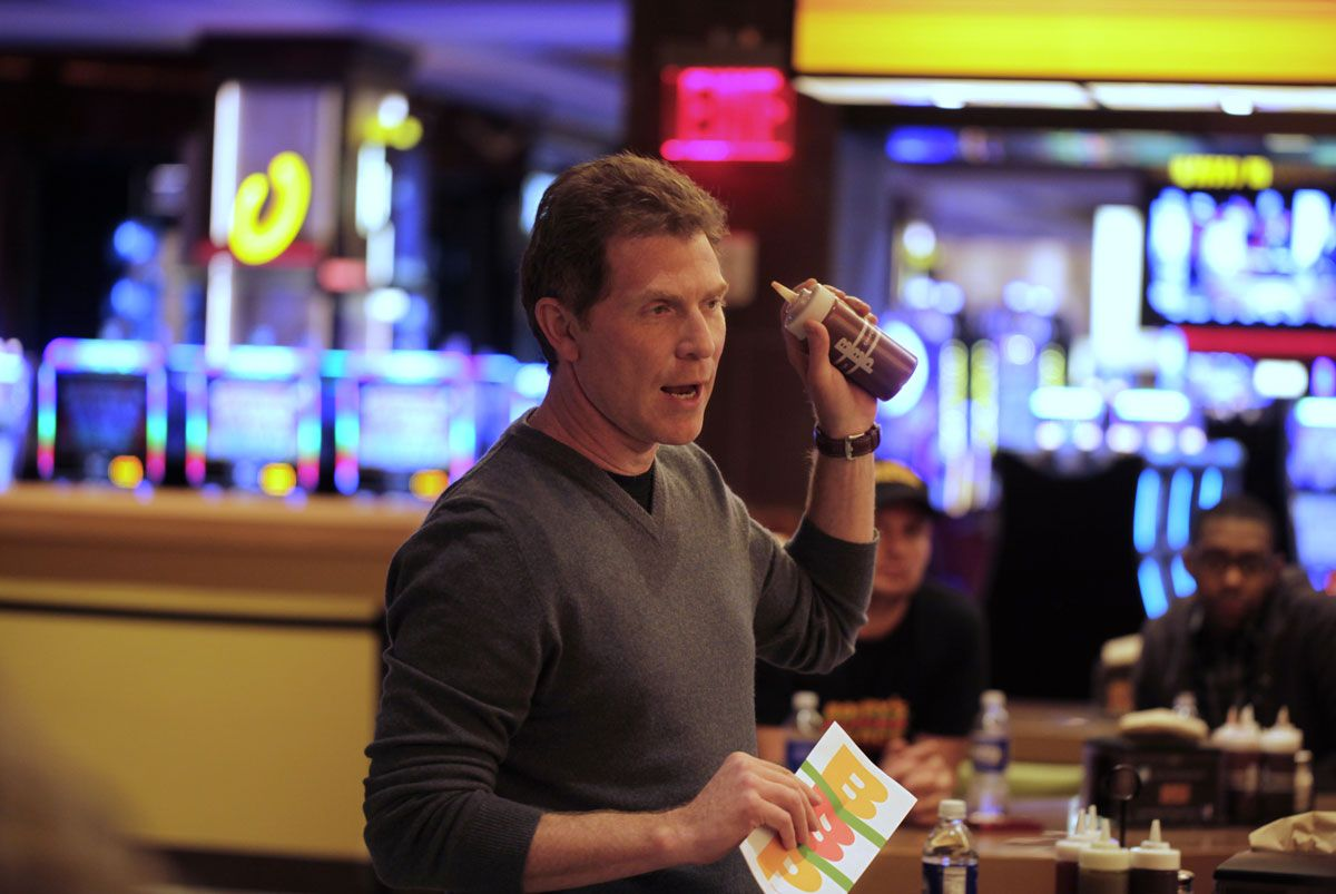 Celebrity chef Bobby Flay talks to some of the media at