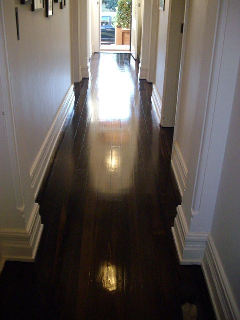 Dark polished timber floors and large skirts