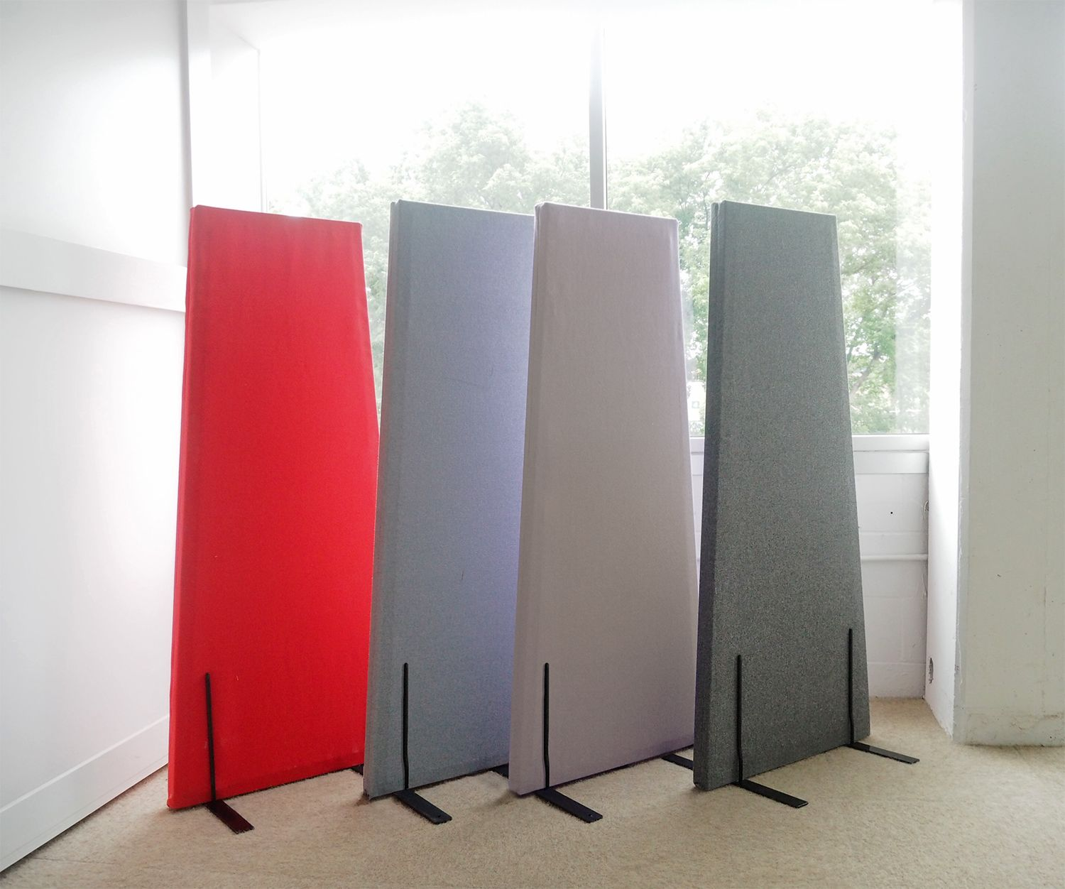 The monolith is a freestanding sound panel that creates an elegant