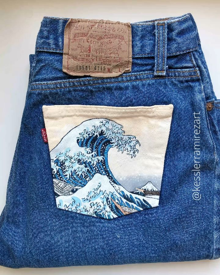 Custom order of The Great Wave painted on vintage Levi's! 🌊  Painted jeans, painted denim, denim art, fabric art, fabric painting, acrylic paint, Hokusai, the Great Wave, the Wave, Wave painting