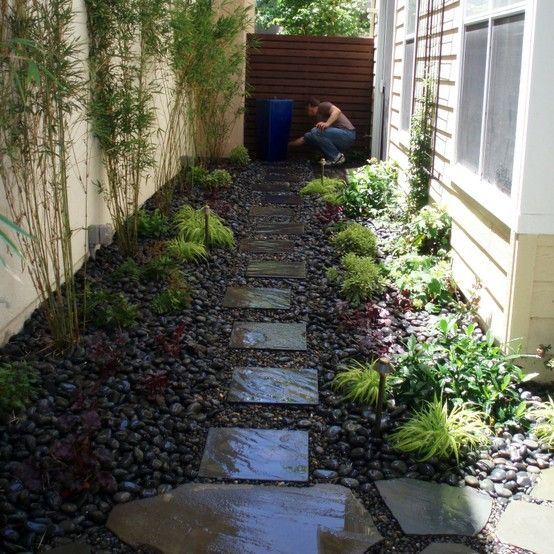 Side Yard With Bamboo, Stepping Stones, River Rock, And